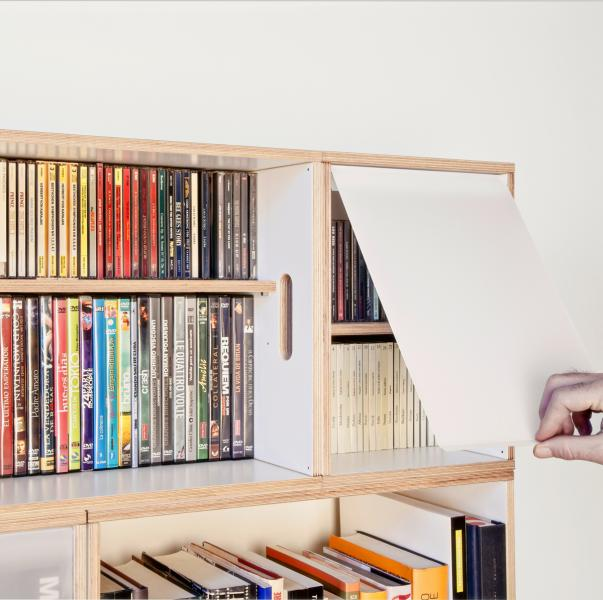 Bookcase with retractable doors