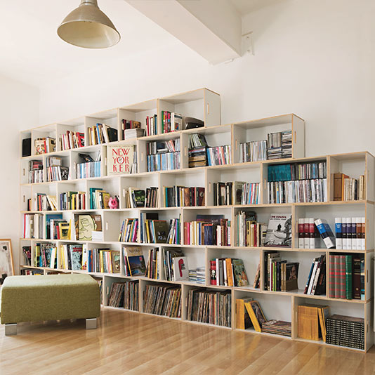 Large wooden bookcase, 6 stories high. Packed with magazines, books, CDs and DVDs. The upper part is built as a ladder shelf.