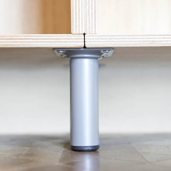 Metal leg to support the weight of the modular wood shelving