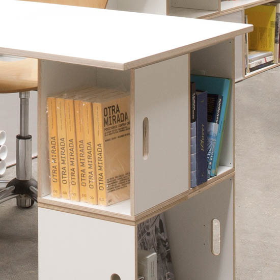 Detail of the leg of the white birch board formed by modular BrickBox shelves. White color.