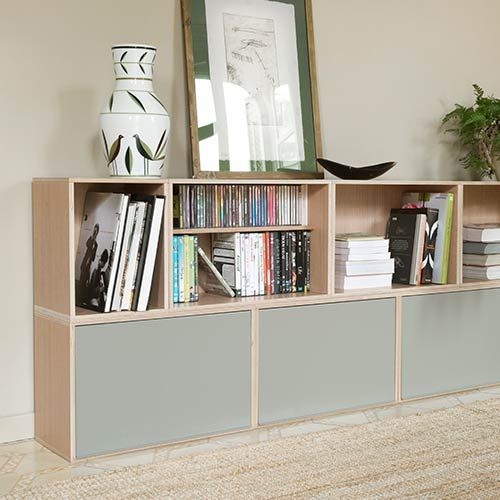Modular furniture with gray doors. With books and records on oak shelves.