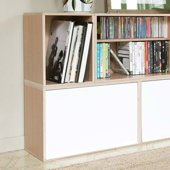 Modular bookshelf with small and big modules. Ideal for CD storage and book storage. With white aluminum doors.