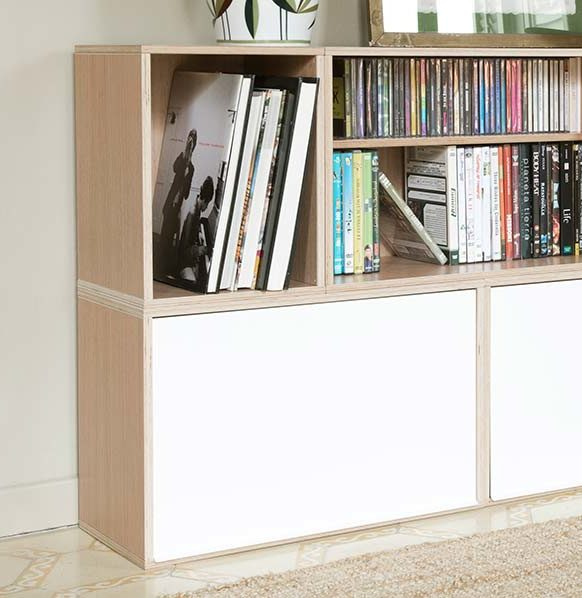 Modular bookshelf with small and big modules. Ideal for CD storage and book storage. With white aluminium doors.