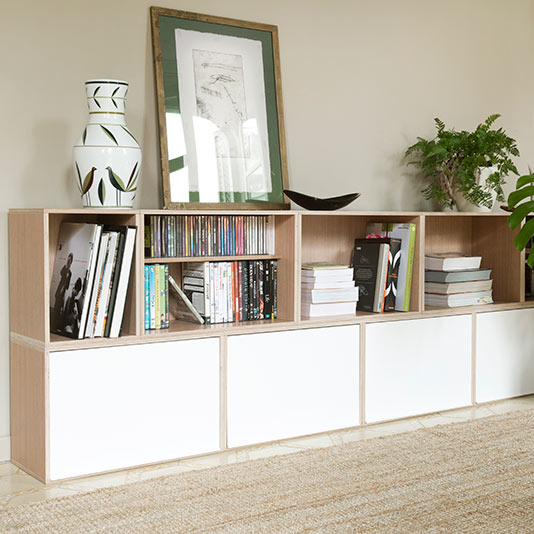 Natural oak wood furniture. Shelf with white aluminum covers. With books of photography, CDs and DVDs.