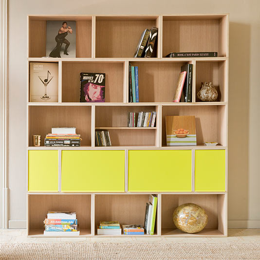Modular oak shelf five stories high with yellow metal doors, large and small.