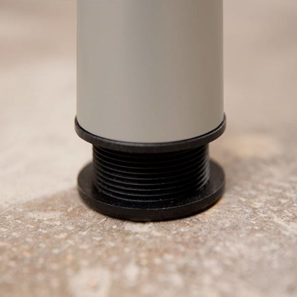 Detail of the gray BrickBox metal leg where you can see that the leg is adjustable