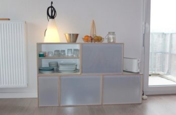 Modular shelf as auxiliary furniture in living room. Shelving for storing dishes, glasses and kitchen and dining utensils.