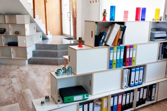 BrickBox shelf as furniture under stairs and room divider in an office