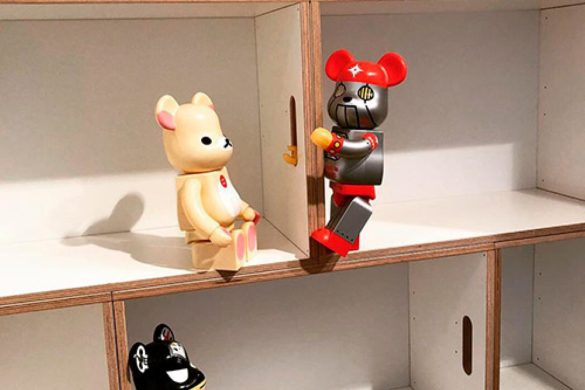 Bookshelf with toys. Three very playful bears